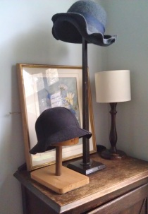 Hat stands and hats in the master bedroom - thesecondhandcity.com