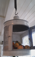 This meat safe was inherited from friends and hangs from the beam above the kitchen bench - thesecondhandcity.com